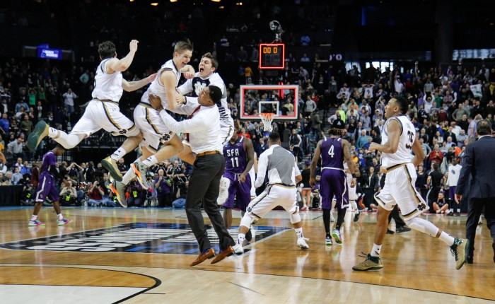 Irish players celebrate following the final buzzer in Notre Dame's 76-75 win over Stephen F. Austin on Sunday at Barclays Center.
