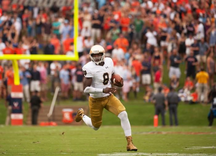 Senior quarterback Malik Zaire runs upfield during Notre Dame's 34-27 victory over Virginia in Charlottesville on Sept. 12.