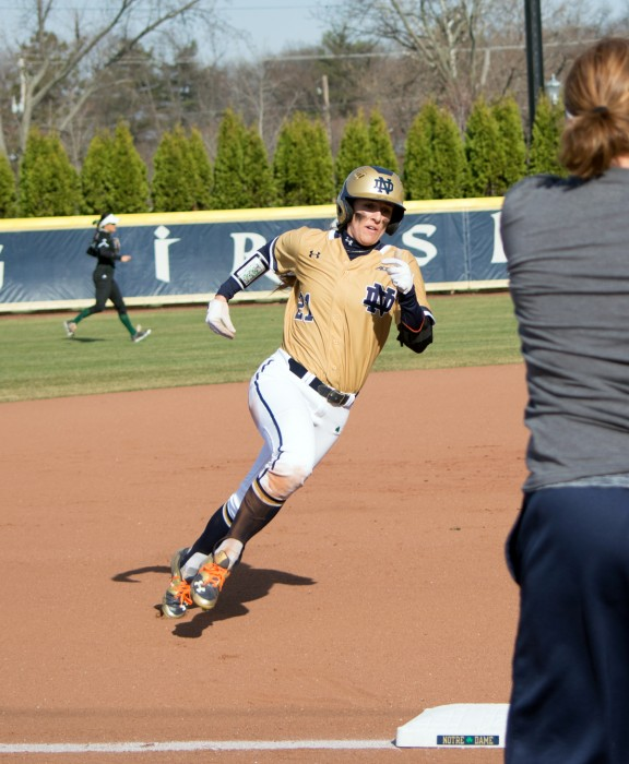 Irish junior center fielder Karley Wester rounds third base during Tuesday's 10-2 victory over Eastern Michigan at Melissa Cook Stadium. She scored two runs on a hit and a walk in the game.