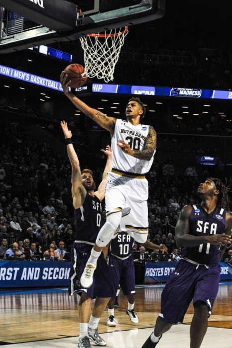 Irish senior forward Zach Auguste attempts a layup during Notre Dame's 76-75 victory over Stephen F. Austin Sunday. With the win, the Irish earned a spot in the Sweet 16 against Wisconsin.