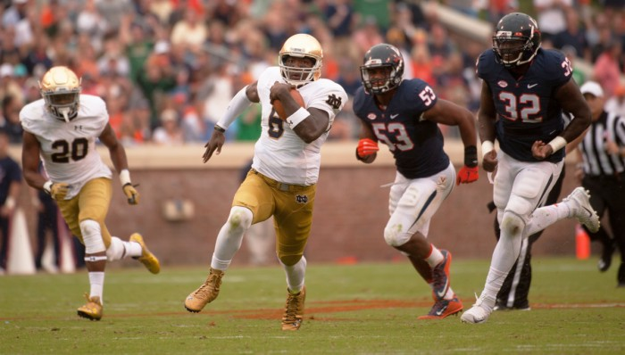 Irish senior quarterback Malik Zaire carries the ball during Notre Dame's 34-27 win at Virginia on Sept. 12 at Scott Stadium. Zaire, who won the starting job last season, fractured his ankle in the victory.