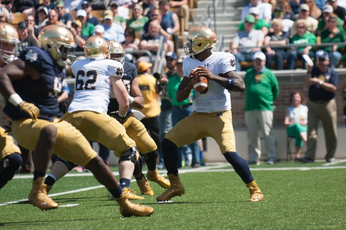 Senior quarterback looks for an open receiver during Notre Dame's Blue-Gold Game at Notre Dame Stadium.