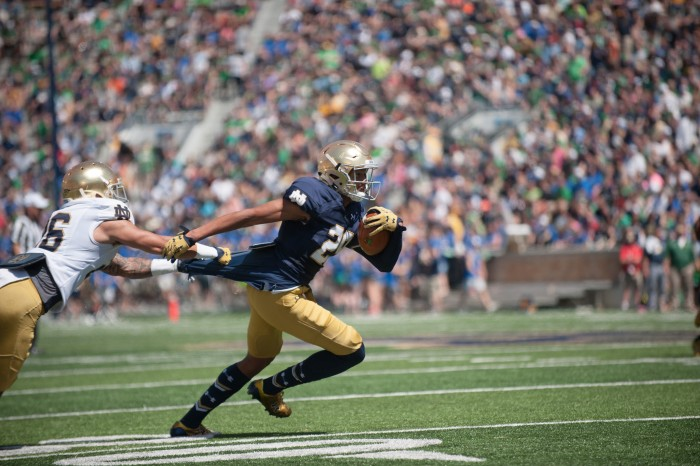 Freshman receiver Kevin Stepherson tries to break away from a defender during Notre Dame's Blue-Gold Game on Saturday at Notre Dame Stadium.