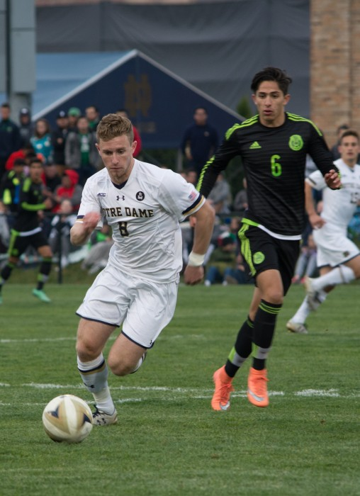 Freshman forward Jon Gallagher dribbles the ball during Notre Dame's 2-1 loss to the Mexican U-20 national team on Friday.