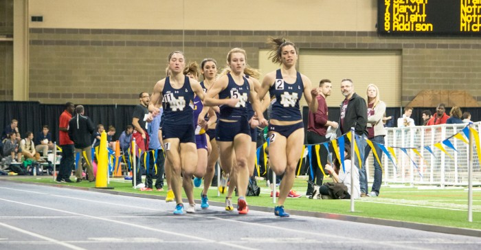 Irish sophomore Jessica Harris, 2, leads the pack during the 800-meter run at the Alex Wilson Invitational at Loftus Sports Center on Feb. 20. Harris broke the school record in the 800-meter run Friday.