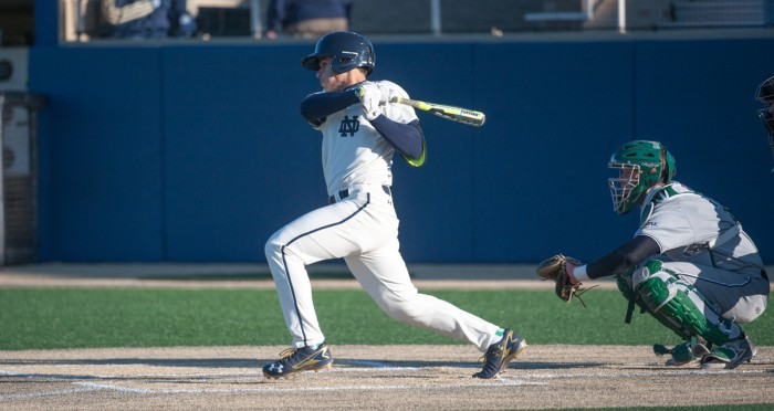 Irish senior catcher Ricky Sanchez finishes a swing during Notre Dame's 4-1 win over Boston College at Frank Eck Stadium on April 15. Sanchez leads the squad with a .345 batting average this season.