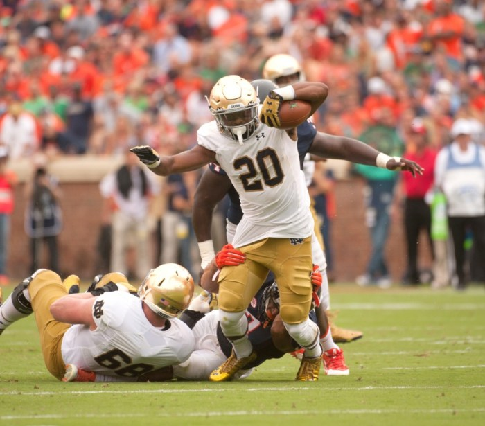 Former Irish running back C.J. Prosise breaks a tackle during Notre Dame's 34-27 win over Virginia on Sept. 12 in Charlottesville, Virginia. Prosise was the first Notre Dame running back drafted since Theo Riddick was picked in the sixth round of the 2013 NFL Draft on Friday.