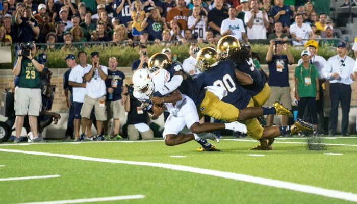 Former Irish linebacker Jaylon Smith sacks the quarterback during Notre Dame's 38-3 win over Texas on Sept. 5 at Notre Dame Stadium.
