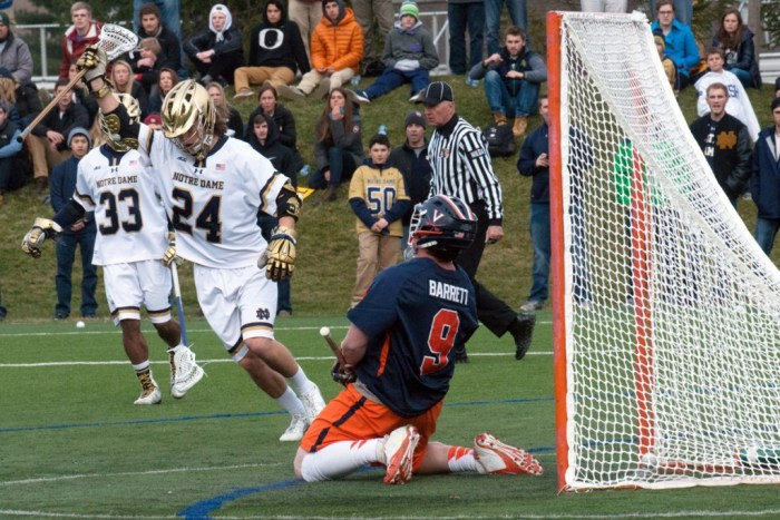 Notre Dame sophomore attack Mikey Wynne celebrates after scoring a goal in ND's 8-7 overtime win over Virginia on March 19.