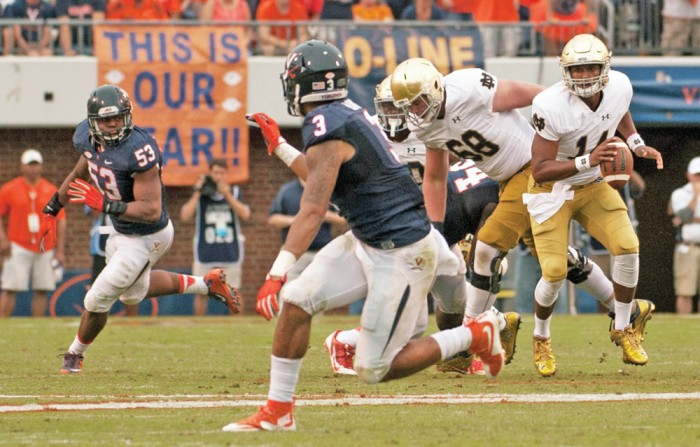 Irish junior quarterback DeShone Kizer scrambles during Notre Dame's 34-27 win at Virginia on Sept. 12. After entering for the injured Malik Zaire, Kizer beat Virginia, then went 8-3 as a starter the rest of the way.