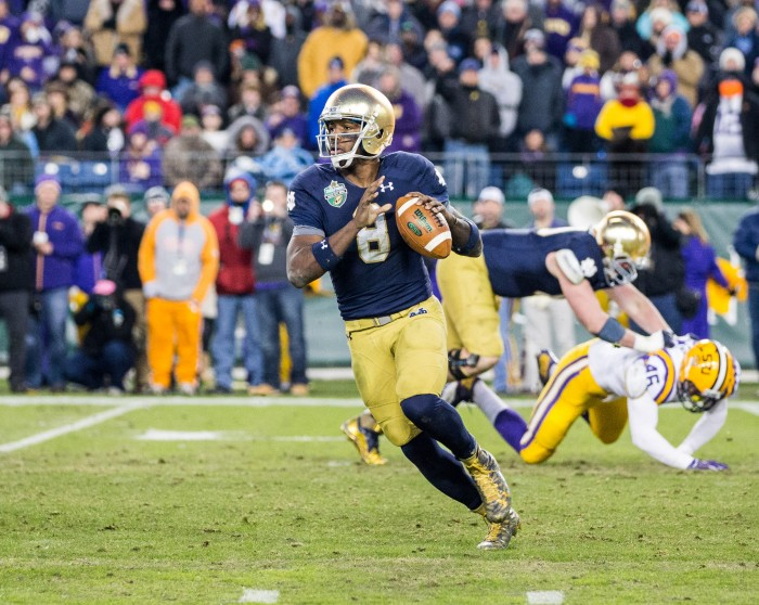 Irish senior quarterback Malik Zaire rolls out to pass during the Music City Bowl on Dec. 30, 2014.
