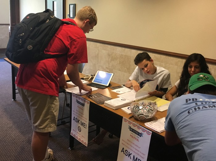 A student registers to vote in the Coleman-Morse Center as part of ND Votes'  Welcome Weekend  registration drive. Volunteers registered first-year and transfer students to vote in the 2016 election.
