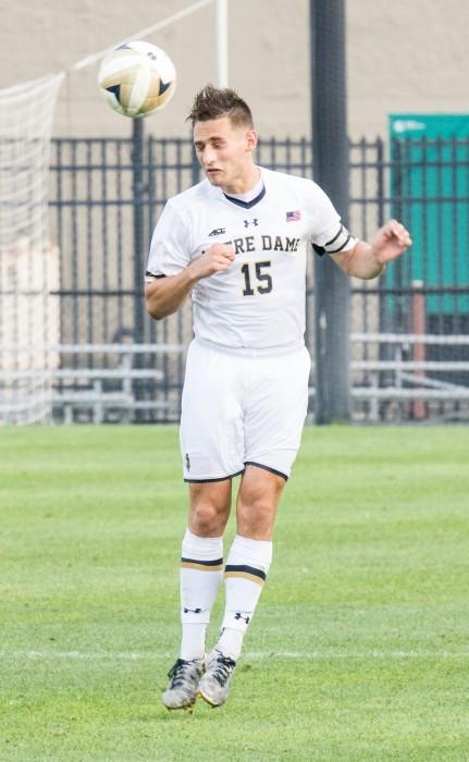Irish graduate student midfielder Evan Panken heads the ball out of Irish territory during Notre Dame's 1-0 win over New Mexico on Sunday at Alumni Stadium.