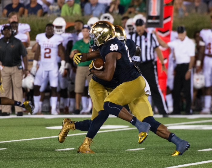 Irish senior running back Tarean Folston receives a handoff during Notre Dame's 38-3 victory over Texas on Sept. 5 at Notre Dame Stadium. Folston is returning from a torn ACL suffered in last year's game against Texas.
