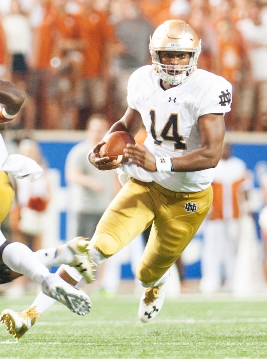 Irish junior quarterback DeShone Kizer rushes during Notre Dame's 50-47 loss against Texas on Sunday at Darrell K. Royal–Texas Memorial Stadium. Kizer accounted for 36 of Notre Dame's 47 points.