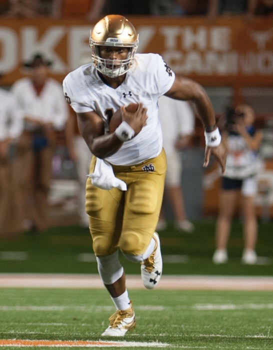 Irish junior quarterback DeShone Kizer carries the ball upfield during Notre Dame's 50-47 loss to the Longhorns on Sunday.