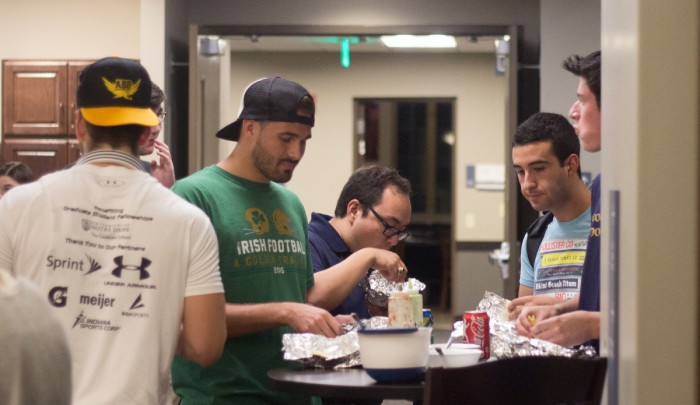 Students enjoy tacos in Dunne Hall on Thursday for the grand opening of Dungeon Tacos.