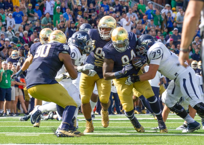 Graduate student defensive lineman Jarron Jones runs toward the end zone following his interception Saturday in Notre Dame's 39-10 win over Nevada.