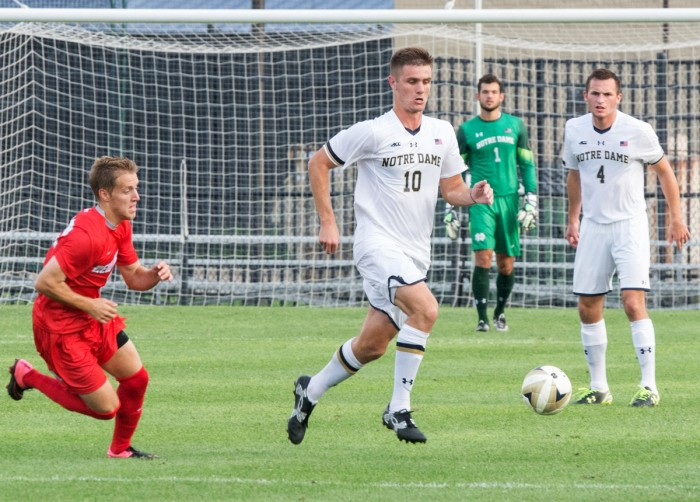 Senior defender Brandon Aubrey dribbles past a New Mexico player during a game at Alumni Stadium on Aug. 28. The Irish won 1-0 and were crowned champions of the Mike Berticelli Memorial Tournament.