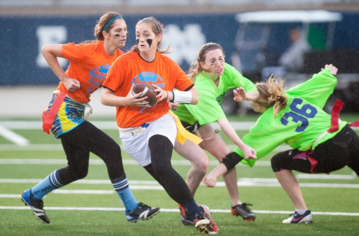 A student representing Welsh Family Hall evades a defender from Pangborn Hall during a women's interhall flag football championship in Notre Dame Stadium in Nov. 2014.