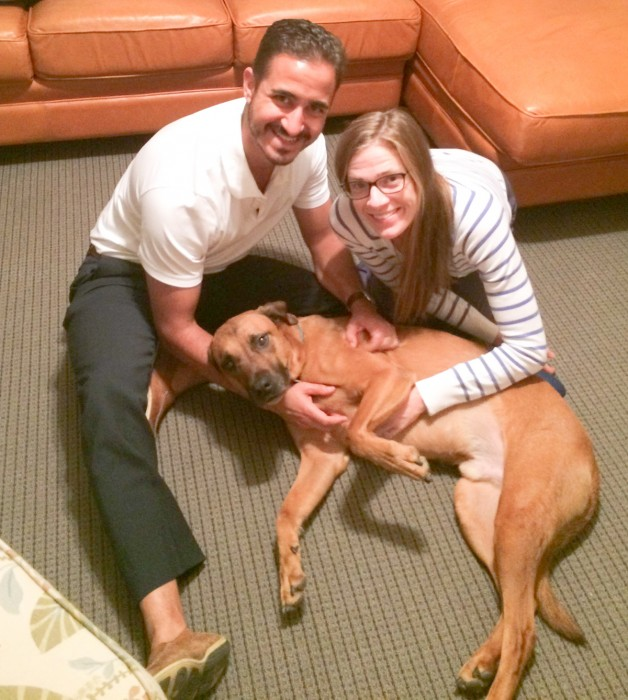 Keenan Hall rector Noel Terranova and his wife Jaclyn pose with their dog, The Goose, who lives with them in the dorm.