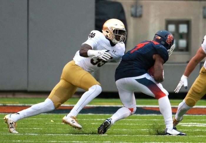 Irish freshman cornerback Donte Vaughn makes a tackle during the 50-33 Notre Dame win against Syracuse last Saturday.