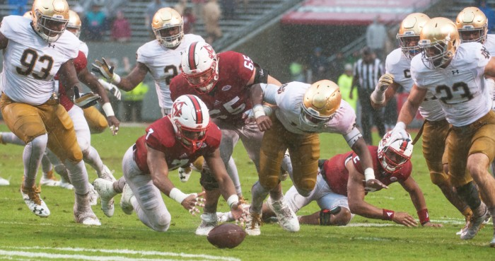 Notre Dame plays dive for a loose ball during Saturday's 10-3 loss to North Carolina State at Carter-Finley Stadium.