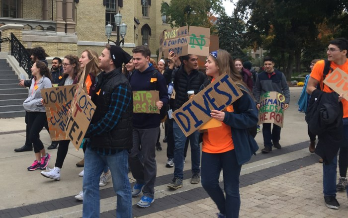 Led by sophomore Adam Wiechman, students in Fossil Free ND march in a protest in October.