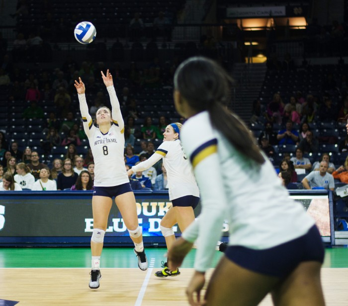 Irish junior setter Caroline Holt sets up a spike during Notre Dame's 3-1 win over Duke on Sept. 30 at  Purcell Pavilion. Holt has 834 assists so far this season, and she is averaging nearly 11 assists per set.