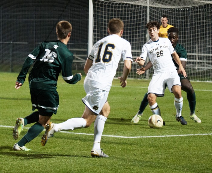 Irish senior midfielder Mark Gormley, right, looks to make a pass  during Notre Dame's 1-0 loss to Michigan State on Tuesday.