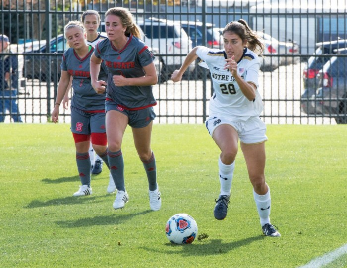 Irish junior forward Kaitlin Klawunder races down the sideline with the ball during Notre Dame's 1-0 win over NC State on Sunday at Alumni Stadium. Klawunder sealed the win for the Irish by scoring the game's only goal.