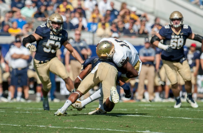 Irish senior receiver Torii Hunter Jr. takes a hit form a Navy defender during Notre Dame's 28-27 loss to the Midshipmen. Hunter Jr. had 104 yards receiving and one touchdown in the contest.