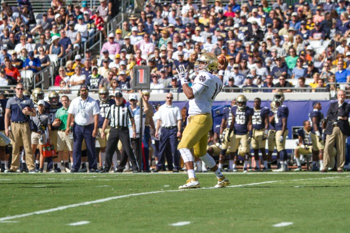 DeShone Kizer winds up to throw a pass toward the sideline.