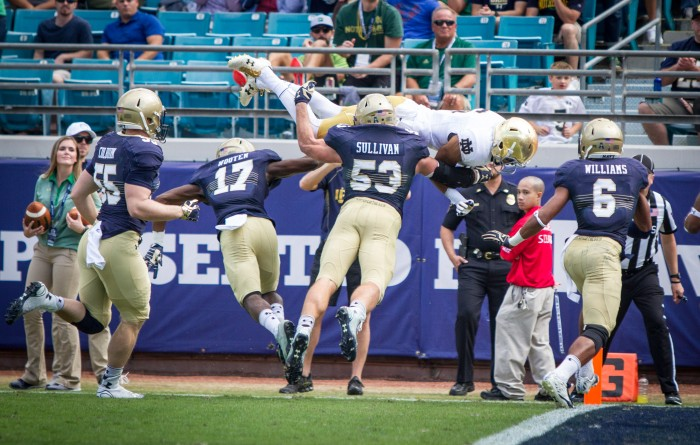 Equanimeous St. Brown completes a 13 yard touchdown by leaping headfirst over the Navy defense.