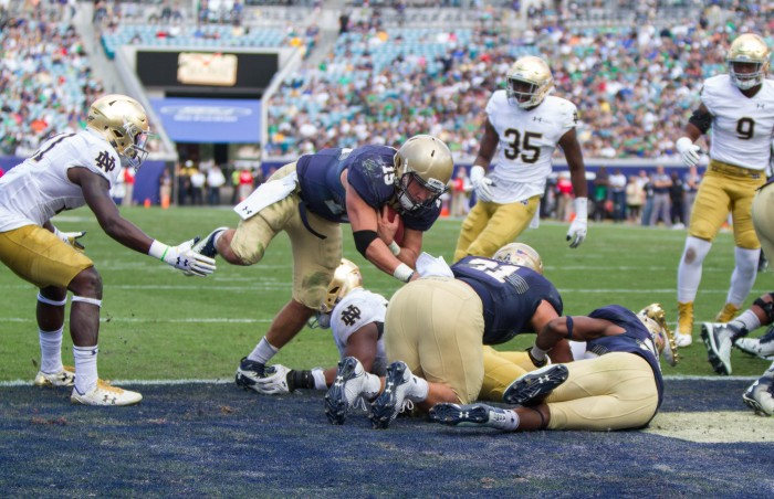 Quarterback Will Worth punches through Notre Dame defense to score the touchdown that would eventually secure the Navy victory.