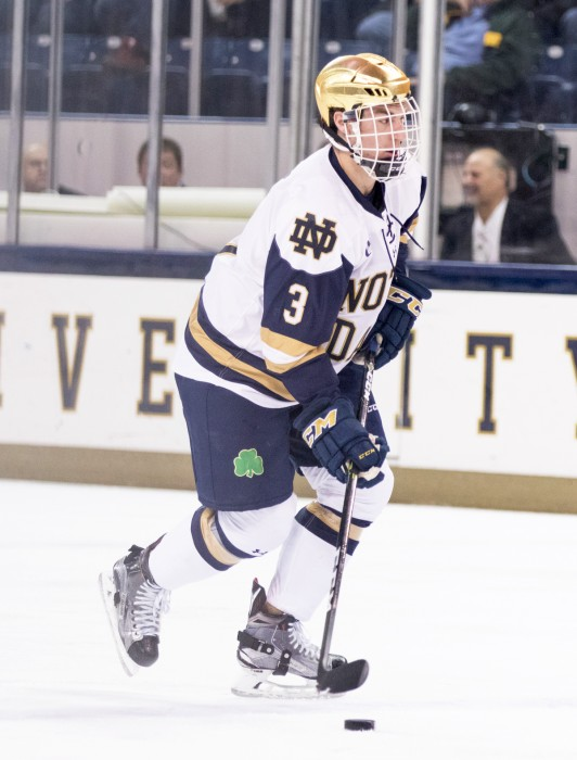 Irish junior defenseman Jordan Gross moves the puck up the Ice in Notre Dame's 4-2 loss to UConn on Oct. 27.