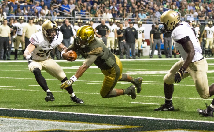 Irish junior quarterback DeShone Kizer dives into the end zone during Notre Dame's 44-6 win in San Antonio on Saturday.