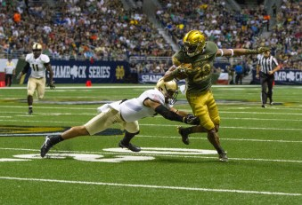 Irish receiver Kevin Stepherson attempts to get by a tackler.