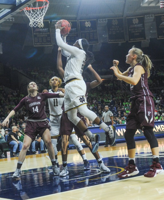 Sophomore guard Arike Ogunbowale lays it up during the 67-36 win over Fordham on Nov. 14 as junior Brianna Turner looks on.