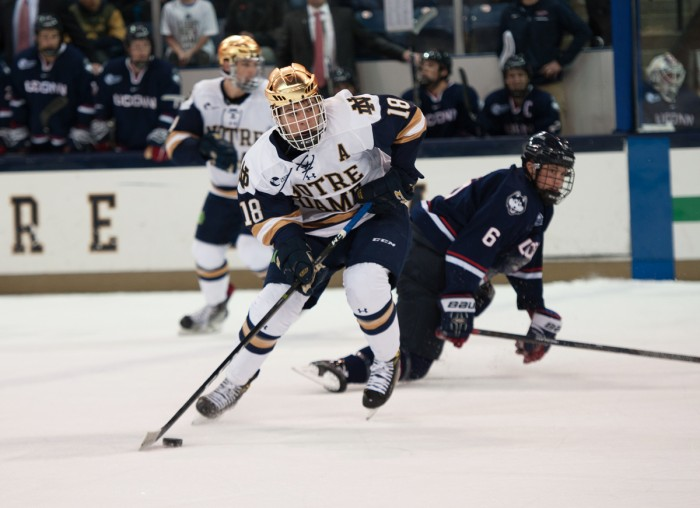 Irish junior forward Jake Evans looks up the ice during Notre Dame's game against UConn on Oct. 27 at Compton Arena.