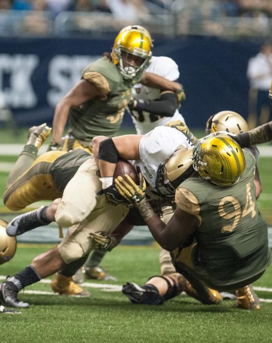 Irish graduate student defensive lineman Jarron Jones makes a tackle during Notre Dame's 44-6 victory over Army in San Antonio on Nov. 12.
