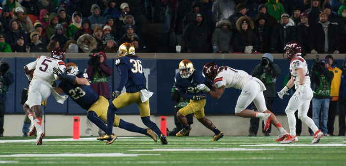 Irish junior safety Drue Tranquill makes a tackle while senior Cole Luke looks on during Notre Dame's 34-31 loss to Virginia Tech on Saturday.