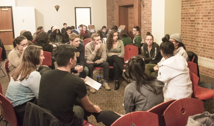 Students participate in group discussions during Tuesday night's forum in the Hospitality Room of South Dining Hall. The forum discussed ways to build a more inclusive Notre Dame community.