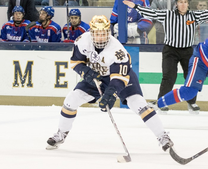 Irish junior forward Anders Bjork settles the puck and surveys the ice during Notre Dame's 4-1 loss to UMass Lowell on Nov. 17.