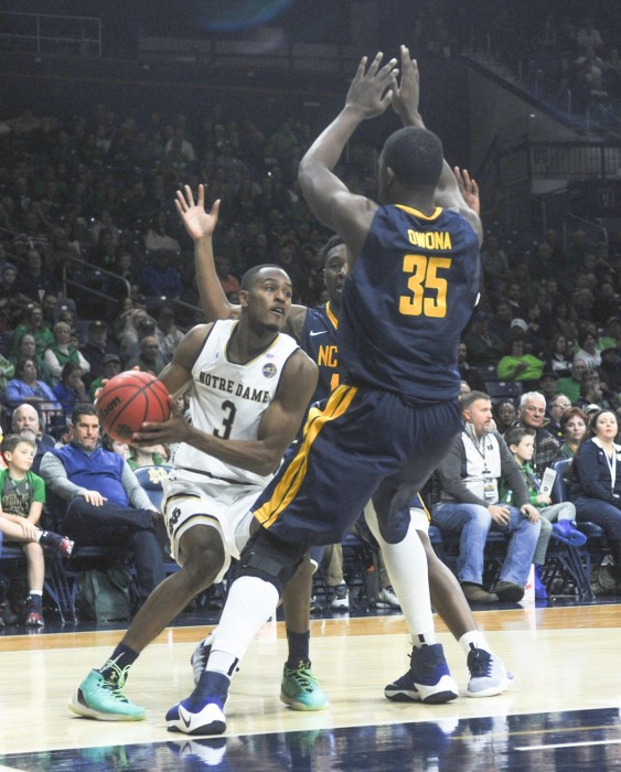 Irish senior forward and captain V.J. Beachem looks to escape a baseline trap during Notre Dame's 107-53 win over North Carolina A&T on Sunday at Purcell Pavilion. Beachem had 19 points in the win.
