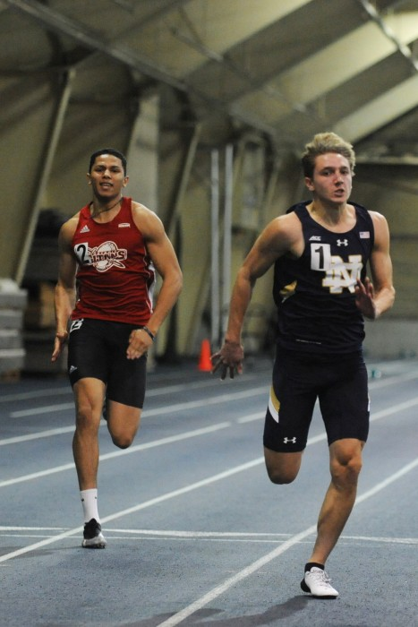 Irish sophomore Zachary Zajdel crosses the finish line in the 60-meter dash during the Blue and Gold Invitational on Friday.