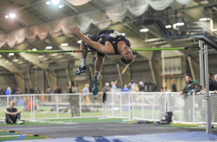 Irish junior Hunter Holton attempts to clear the bar during the Blue & Gold Invitational on Friday at Loftus Sports Complex.