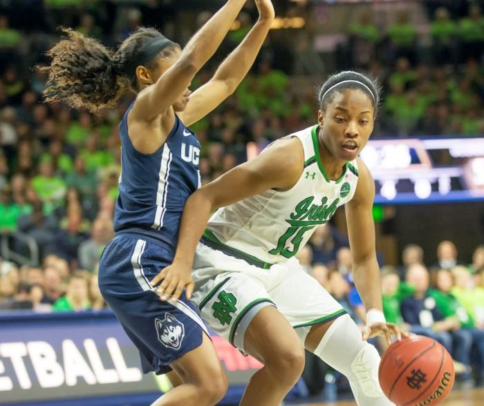 Irish senior guard Lindsay Allen dribbles around a defender in Notre Dame's 72-61 loss to the Huskies on Wednesday.