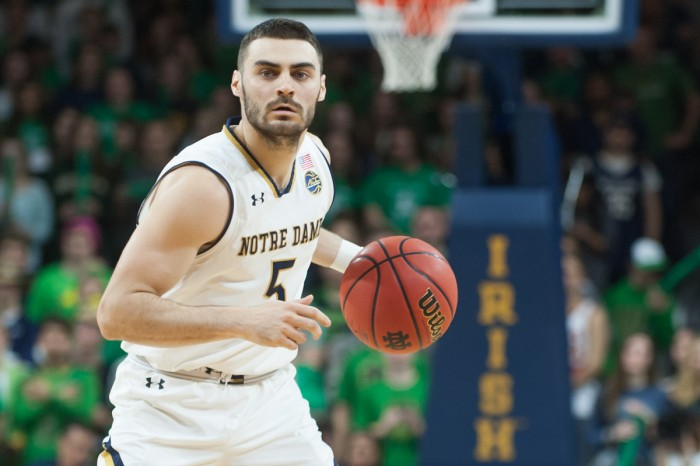 Junior Irish guard Matt Farrell dribbles up the court in Notre Dame's 84-66 victory over Syracuse on Saturday at Purcell Pavilion. Farrell had 15 points and nine assists in the game.