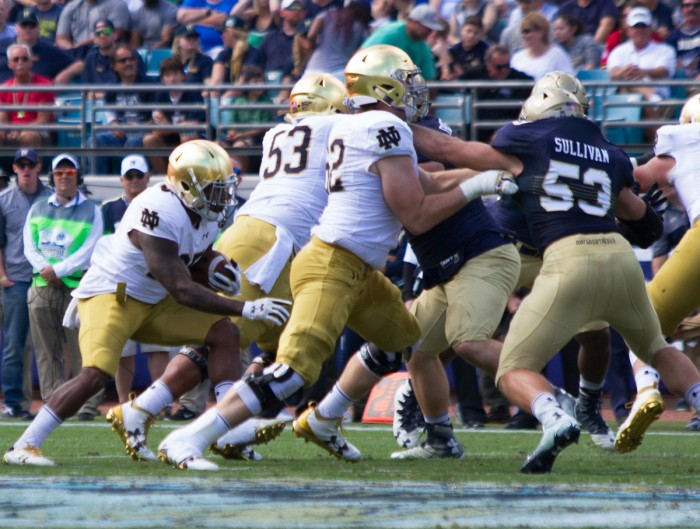 Irish senior offensive lineman Colin McGovern, front, engages a Navy defender during Notre Dame's loss to the Midshipmen on Nov. 5. McGovern announced he will transfer to Virginia for his final season of eligibility after graduating from the University in May.